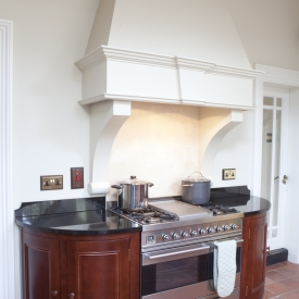 Curved solid wood cabinets  ( hand painted chinmey detail with extractor fan )